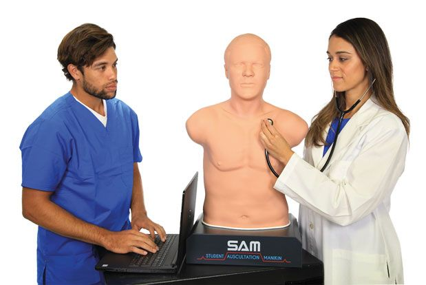 two students train on SAM 3G® Auscultation Trainer